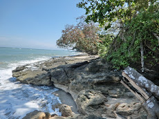 Finding pebbles at Setakang Beach