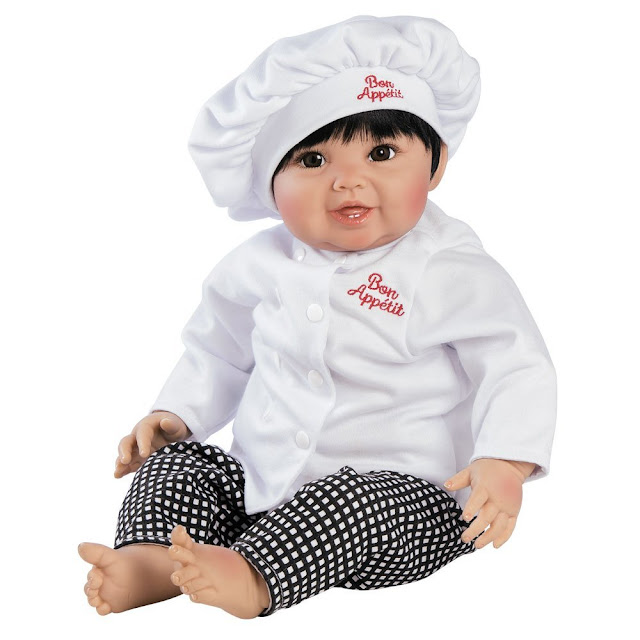 A chef doll with a chef outfit.
