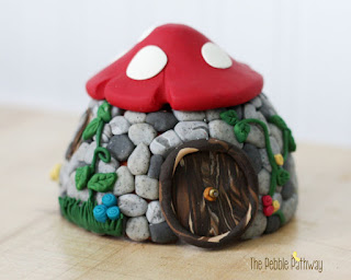 Stone Fairy House with Red Mushroom Roof