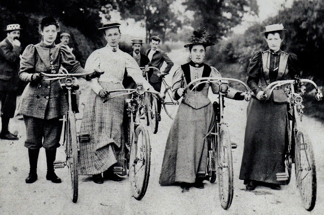 Vintage photo c. 1900. Four female friends, one wearing knee-high pants, pose with their bicycles in the park. Parenting, A Word to Women by Mrs. C. E. Humphry, 1898. marchmatron.com