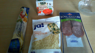 Ingredients for the pizza rolls: salami, grated cheese, puff pastry, pizza sauce