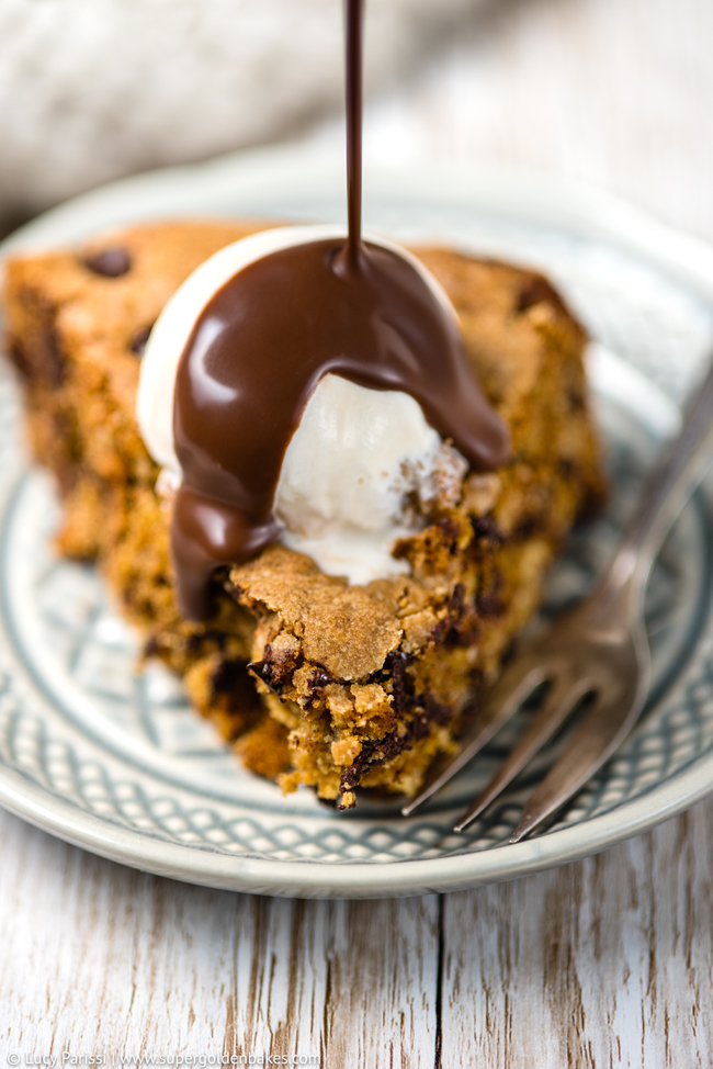 Oat and chocolate chip skillet cookie served with vanilla ice cream and smothered in chocolate sauce