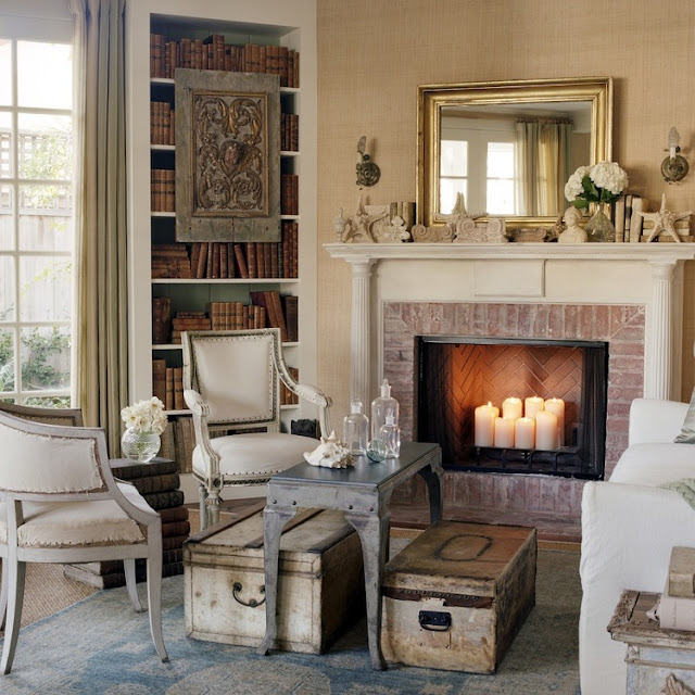 Nordic French furniture near fireplace in California beach cottage in Santa Monica by Giannetti Home