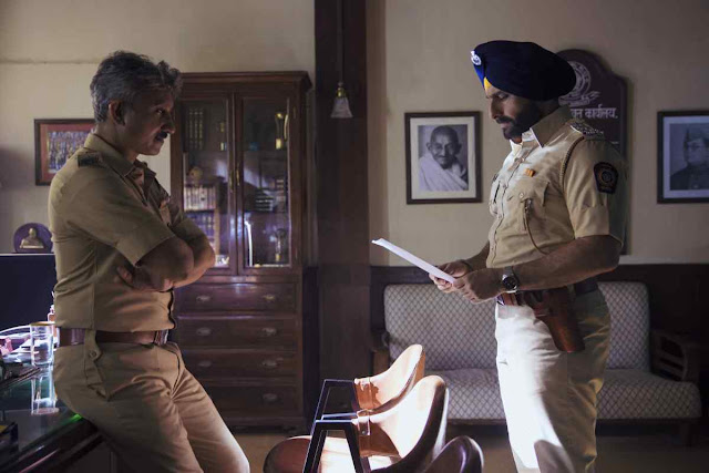 Neeraj Kabi as Officer Parulkar in Sacred Games, Saif Ali Khan as Sartaj Singh, Police Station