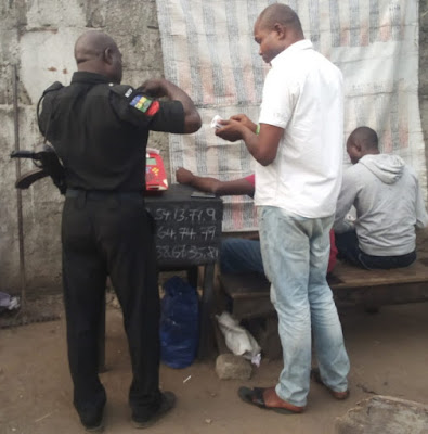 nigerian police officer playing baba ijebu lotto