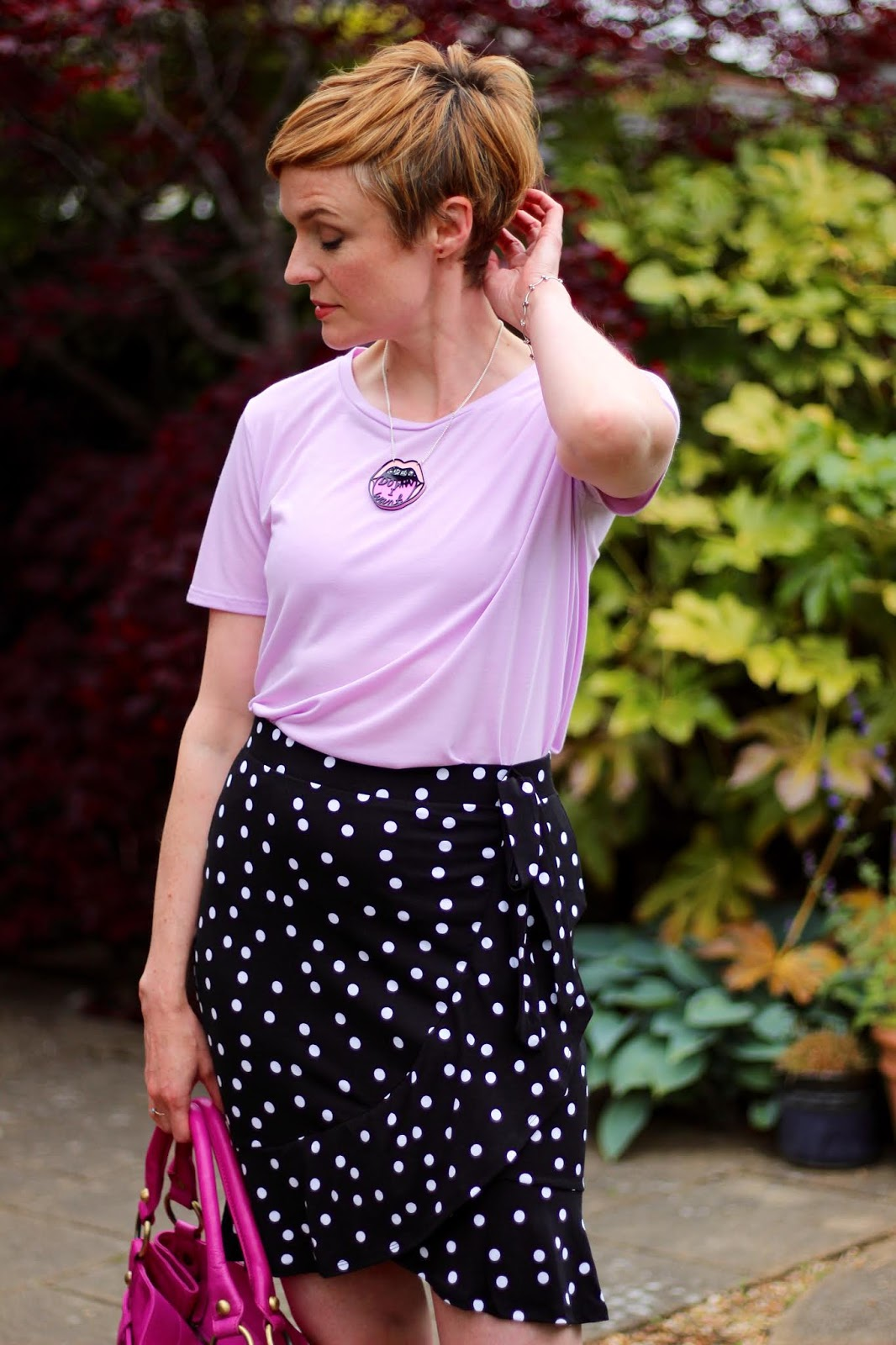 Lilac Tee, Spotty Wrap Miniskirt & Tatty Devine Mouth Necklace | Fake Fabulous