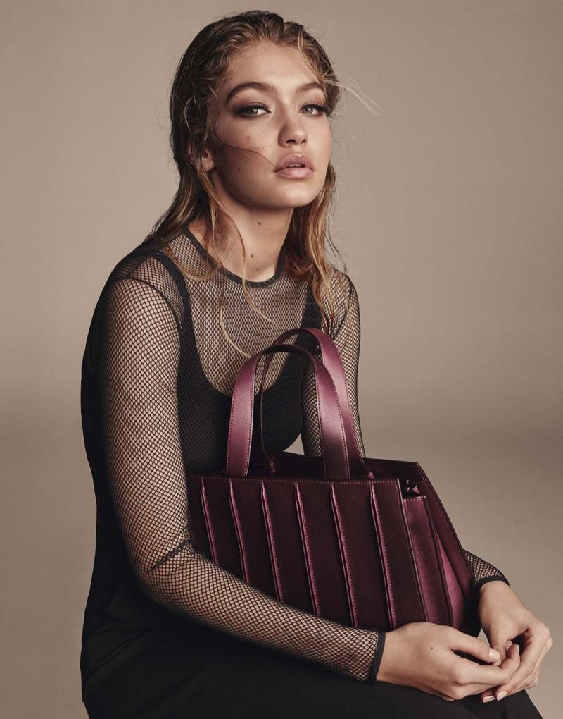 Gigi Hadid poses with the Max Mara Whitney Bag