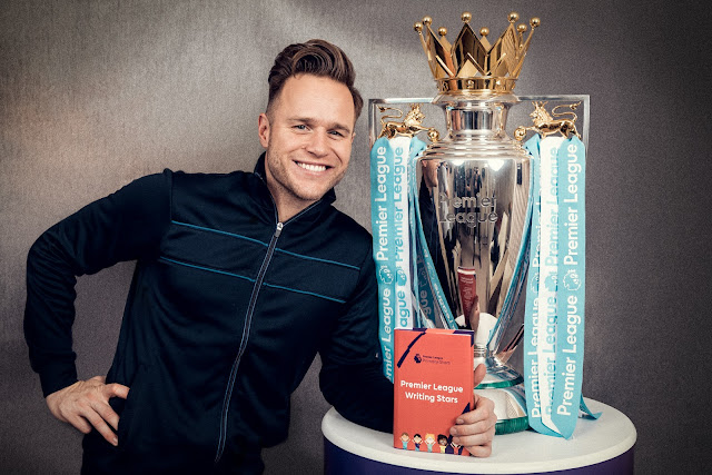 Olly Murs Premier League trophy and book for writing stars campaign