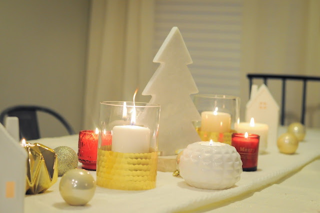 Table runner with glowing candles, marble trees, and metallic bulbs