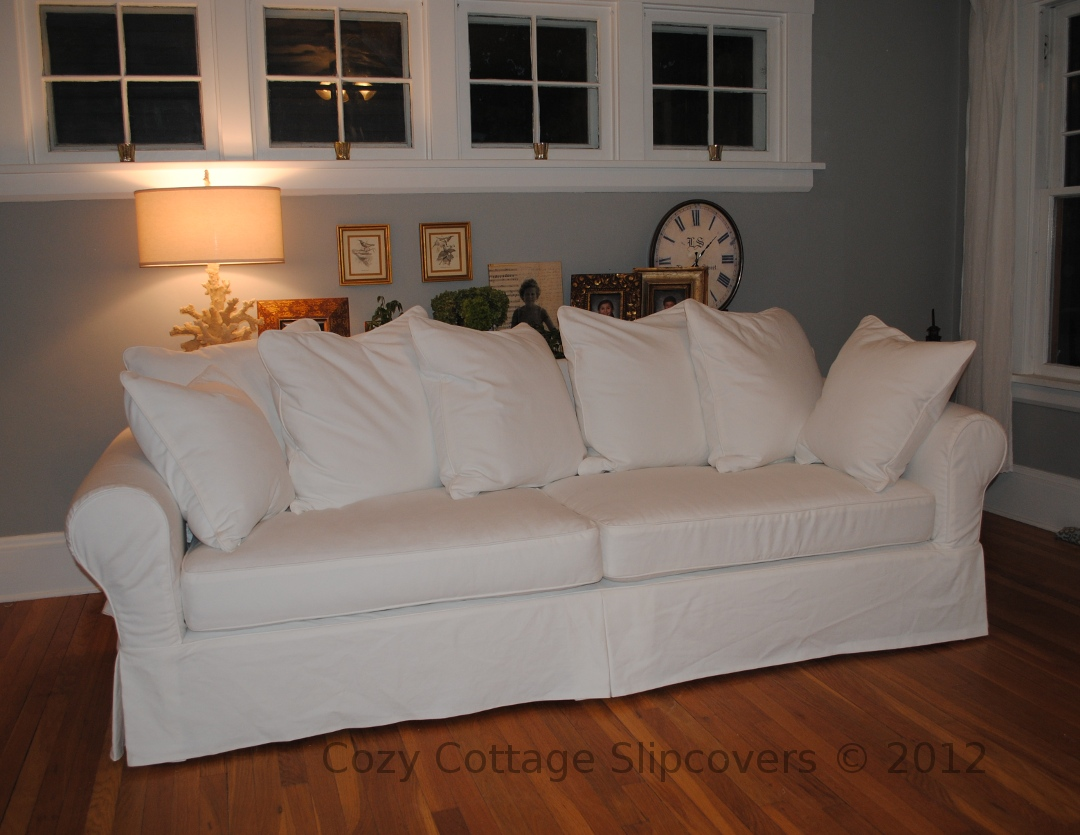 loose pillow back sofa slipcovers how to decorate a lounge with red for sofas