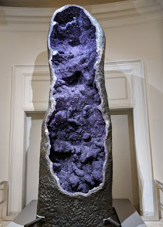 Purple amethyst crystals exposed in a 12-foot tall geode, cut open, American Museum of Natural History, New York, New York