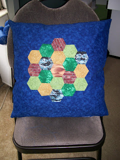 Appliqued hexagon throw pillow
