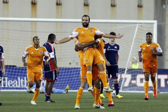 Adam Moffat celebrates his goal against New England Revolution with Houston Dynamo teammates