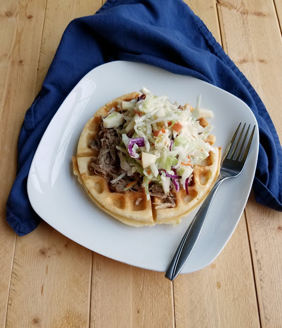 waffle with cider pulled pork and apple slaw