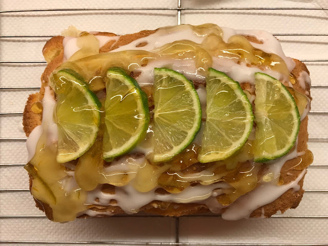 Gin & tonic cake drizzled with icing, marmalade and decorate with lime