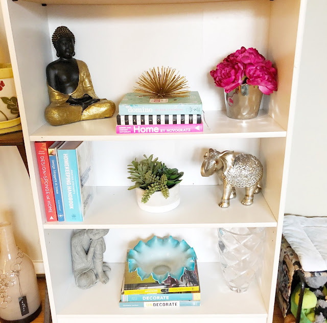 organizing and styling a bookshelf with books and decor