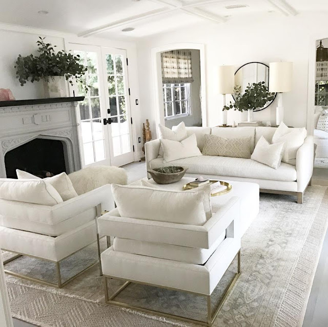 Gorgeous white living room decor in Erin Fetherston's Hollywood home on Hello Lovely