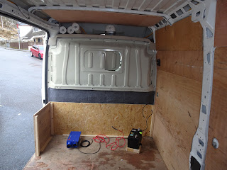 van conversion flooring with battery