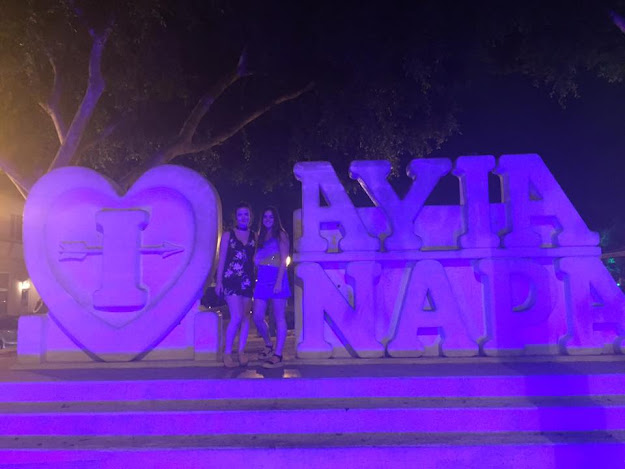 two girls at the Ayia Napa signs