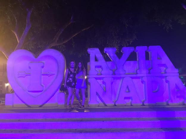 two girls at the Ayia Napa signs