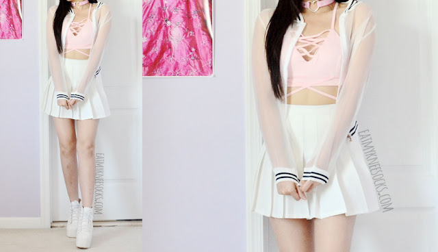 A sporty cute pastel outfit featuring a lace-up lattice front pink bralette crop top from Dresslink, paired with a white pleated American Apparel style tennis skirt and sheer mesh bomber jacket.
