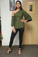 Pragya Jaiswal in a single Sleeves Off Shoulder Green Top Black Leggings promoting JJN Movie at Radio City 10.08.2017 061.JPG