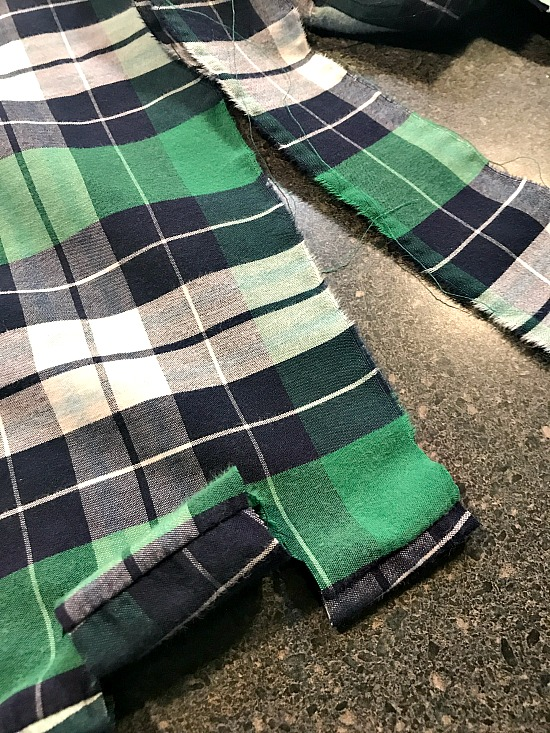 Tearing strips of green plaid
