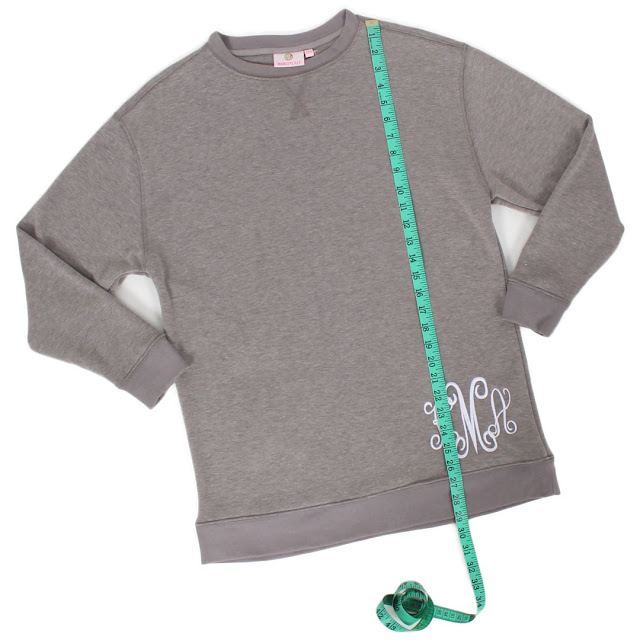 White Background Image of Measuring Tape on Gray Sweatshirt