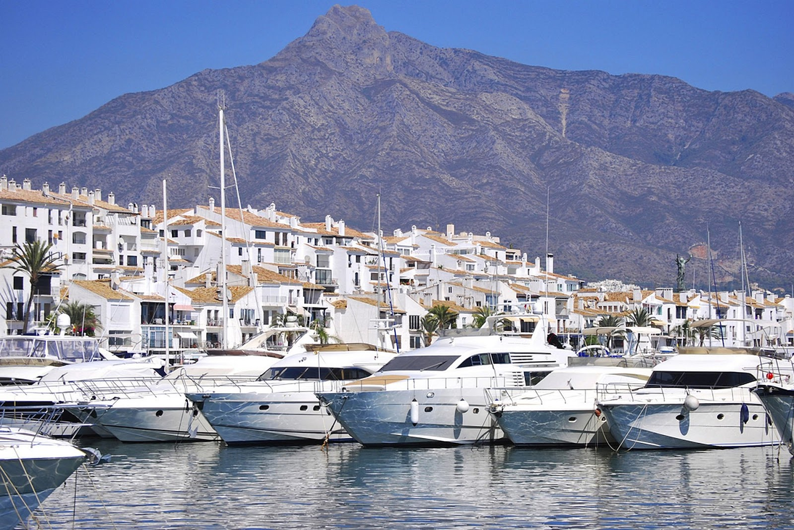 yachts boats mountains marina Puerto Banus
