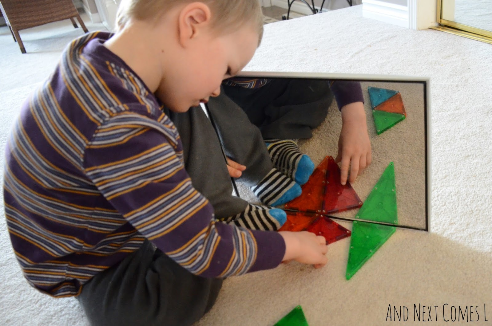 Exploring symmetry with mirrors and Magna-Tiles from And Next Comes L