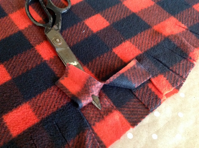 Cut careful slit on the top layer of the plaid fabric
