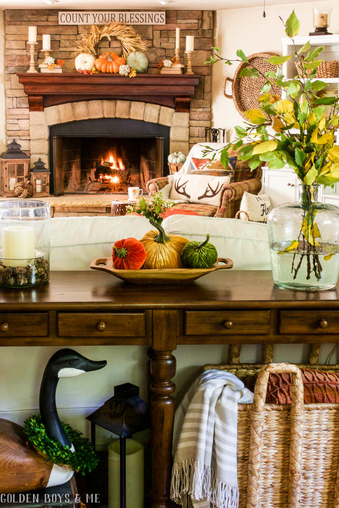 Fall family room with stone fireplace and warm fall colors - www.goldenboysandme.com