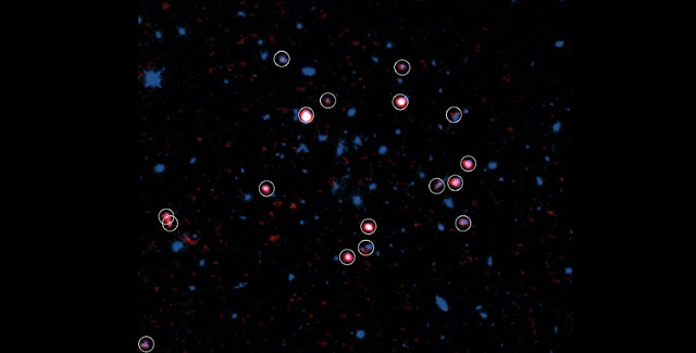 Galaxy cluster XMMXCS J2215.9–1738 observed with ALMA and the Hubble Space Telescope. Gas rich galaxies detected with ALMA are shown in red and marked with circles. Most gas rich galaxies are located in the outer part, not the center, of the galaxy cluster (around the center of the image). Credit: ALMA (ESO/NAOJ/NRAO), Hayashi et al., the NASA/ESA Hubble Space Telescope