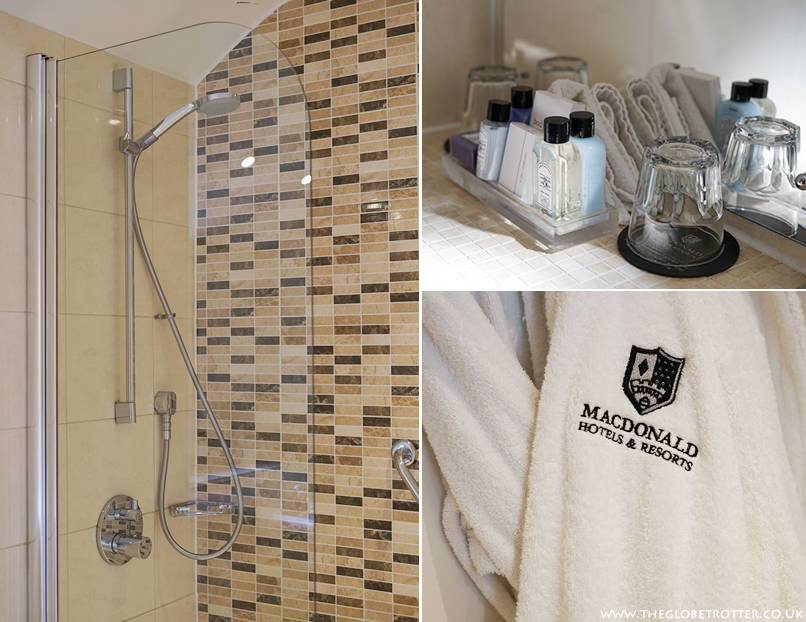 Bathroom stocked with luxury bathrobes and toiletries at the Macdonald Bear Hotel