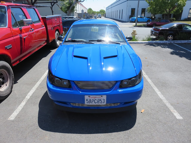 Rockin' custom 2003 Ford Mustang from Almost Everything Auto Body