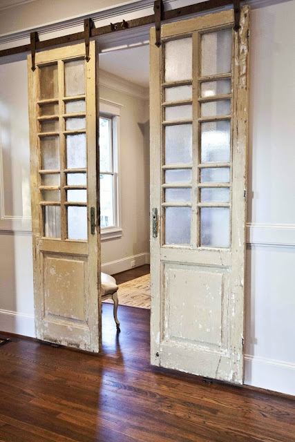 two vintage doors were converted into a barn door