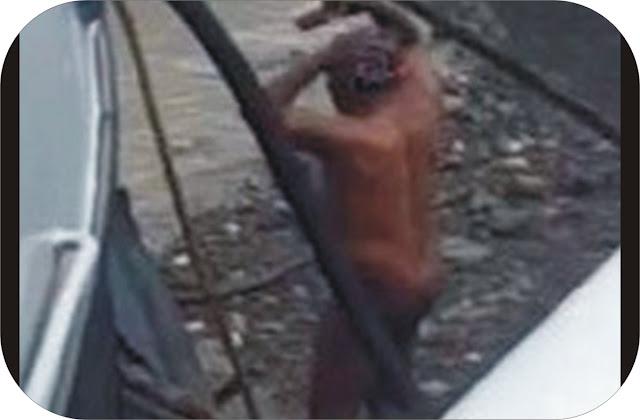 Man washing himself at River Thame