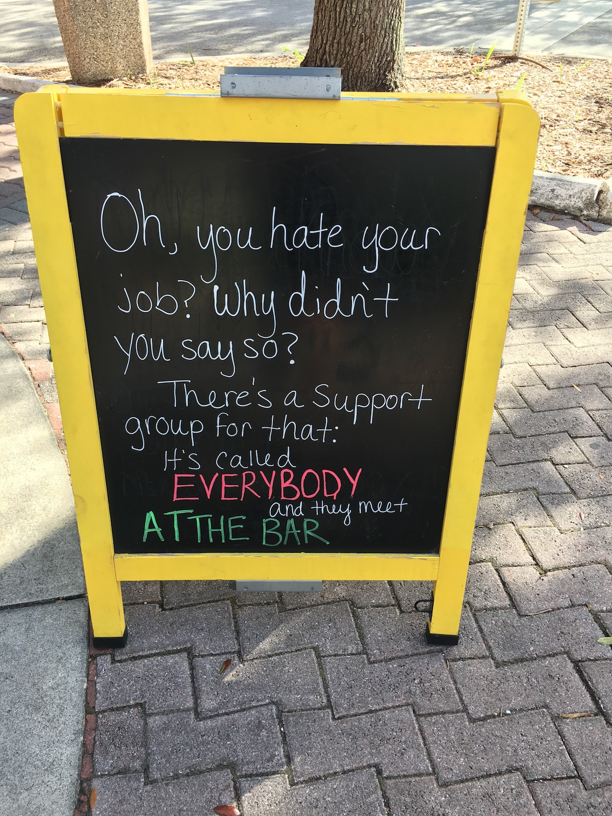 This is a photo of a funny chalkboard in front of a restaurant in Cocoa Beach.