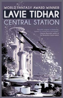 Cover of Central Station, fashioned like a vintage travel poster in pale purple, white, and black. Two spaceships fly past a towering, futuristic structure with several squatter buildings below it. The spaceships trail glitter.