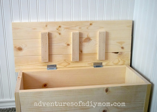 wooden toy box with hinged lid