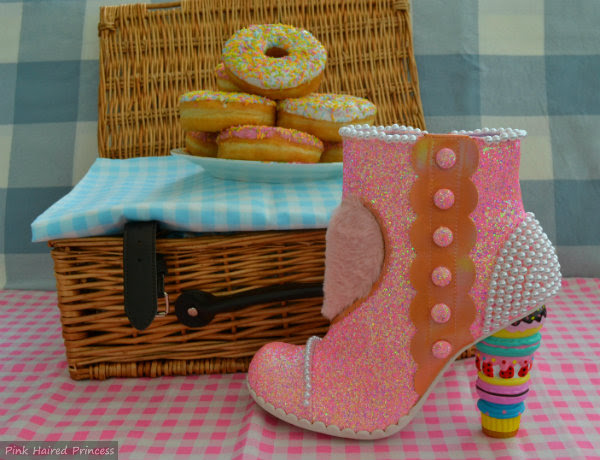 Irregular Choice pink macaron heeled boot in front of picnic basket