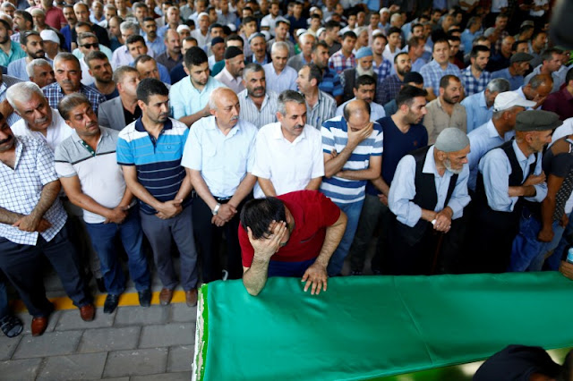 Image Attribute: A family member of a victim of a suicide bombing at a wedding celebration mourns over his coffin during a funeral ceremony in the southern Turkish city of Gaziantep, Turkey, August 21, 2016. REUTERS/Osman Orsal/File Photo