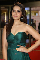 Raashi Khanna in Dark Green Sleeveless Strapless Deep neck Gown at 64th Jio Filmfare Awards South ~  Exclusive 136.JPG