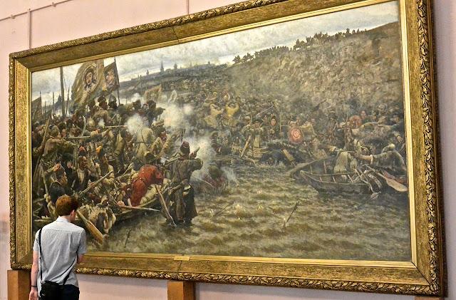 La conquête de la Sibérie par Yermak par Vassili Sourikov  Les Russes (à gauche) fusillent sans pitié avec leurs armes à feu attaquent leurs ennemis qui se défendent avec des arcs et des flèches.