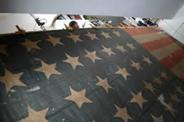 Flag conservation, historic and antique flags and banners, restoration and repair, mounting