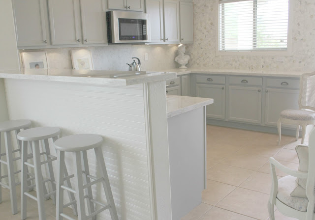 Serene Nordic French kitchen grey and white kitchen with marble statement wall and quartz countertop