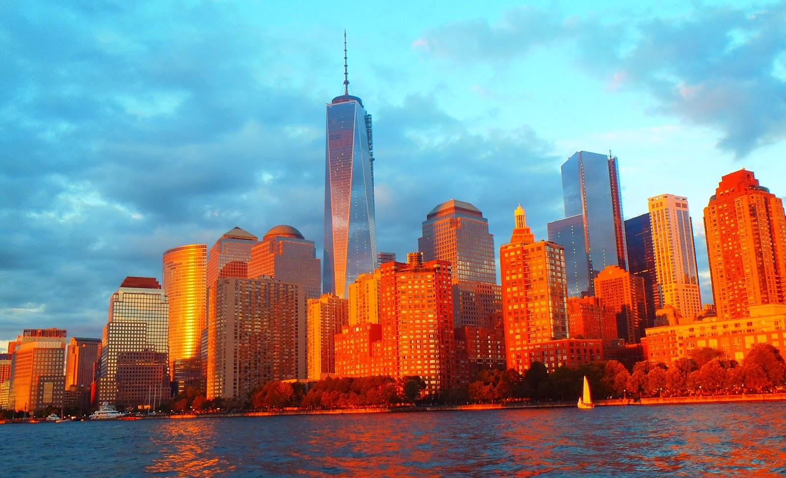 The sun setting on New York city skyline