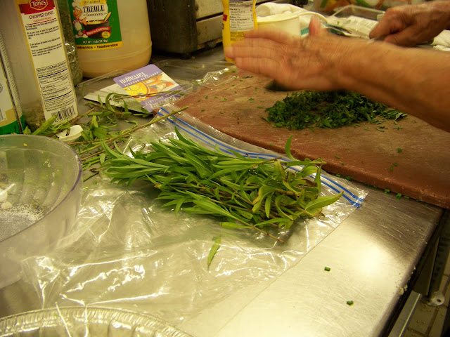 Chopping herbs for the Cauliflower dish