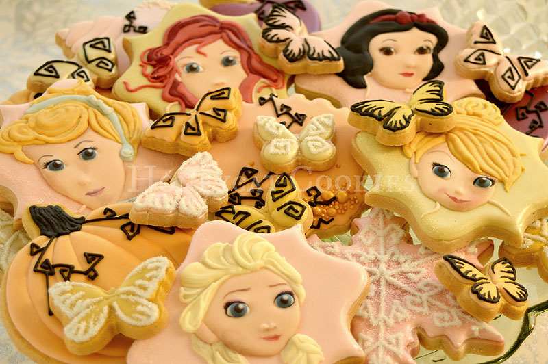 Plateful of Disney princess decorated cookies, Cinderella, Elsa, Snow White, Tinkerbell, Ariel, cookies and photo by Honeycat Cookies