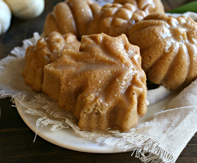 Recipe for lightly spiced cinnamon and ginger mini cakes with a maple glaze.